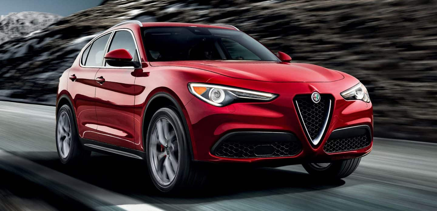 Display A three-quarter front view of the 2019 Alfa Romeo Stelvio being driven on a mountain road.