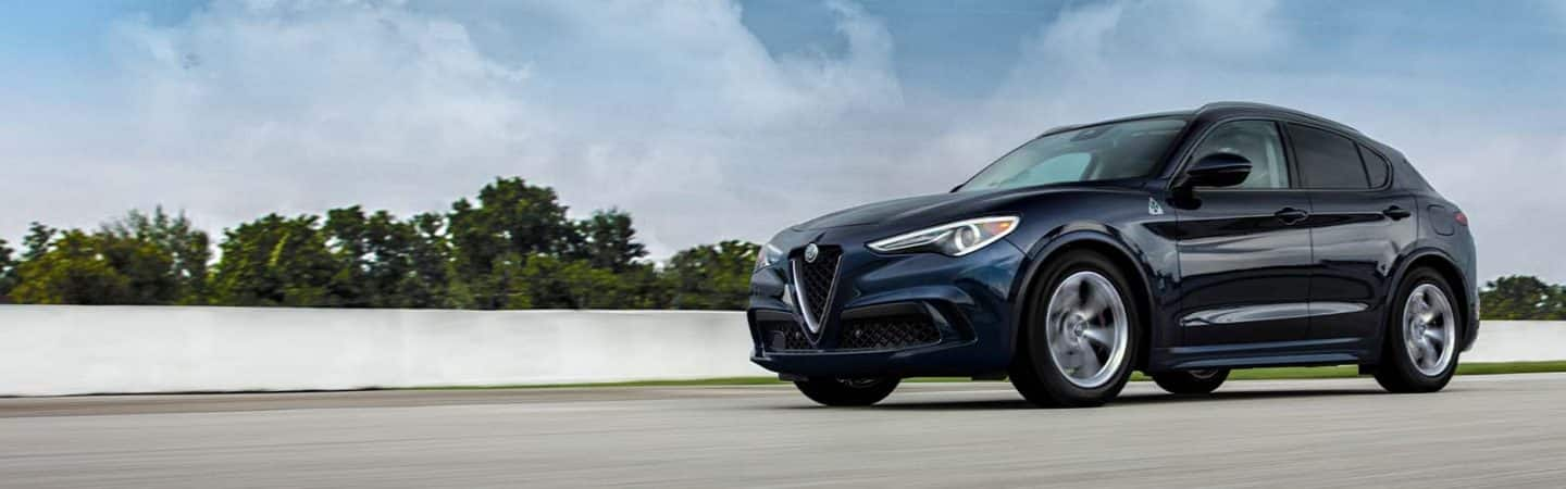 A 2020 Alfa Romeo Stelvio Quadrifoglio being driven on a track.