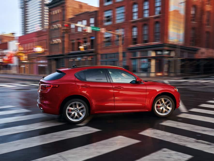 The 2020 Alfa Romeo Stelvio turning right at an intersection.